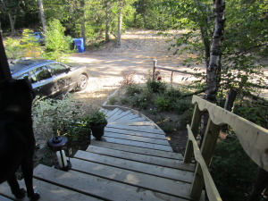 Stairs sweep up to the deck. Stairs were designed and built by Lewis, Alan's brother