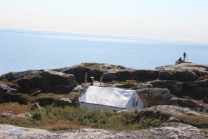 Research tent nestled into the only sheltered spot on the cliff. Breathtaking view for the summer