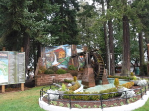 Original waterwheel incorporated into a sculpture and mural